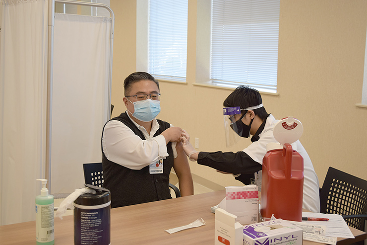 Kwang Lee, Administrator, Margaret Tietz getting vaccinated